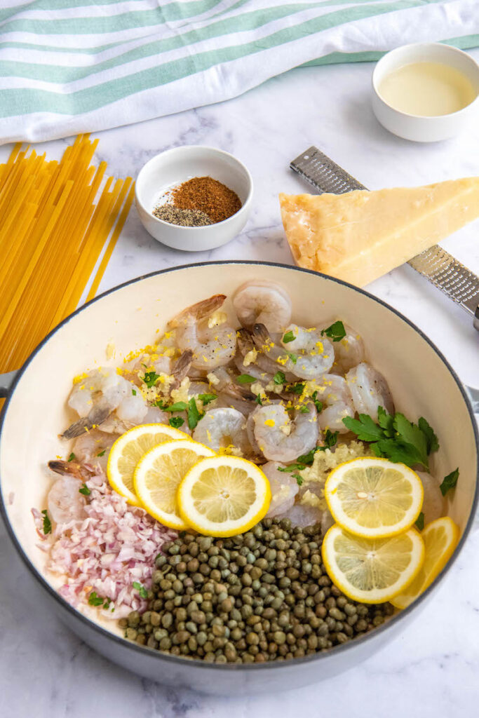 Ingredients for Shrimp Scampi in a large pan.