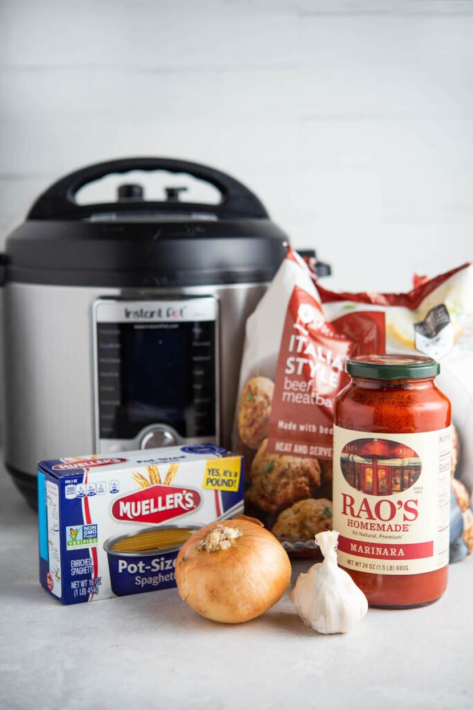 Ingredients for spaghetti with an instant pot in the background.
