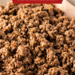 Up close image of ground taco meat in a skillet.