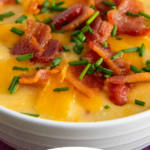 up close image of a bowl of potato soup with toppings on top with wording on the bottom for Pinterest.