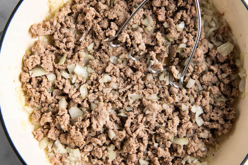 Browned meat and onion in a large skillet.