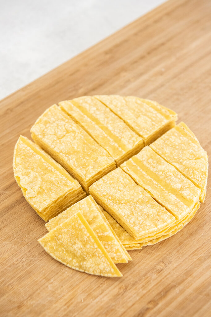 Corn tortillas have been sliced into many pieces.