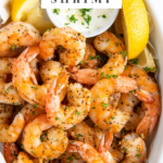 Air fryer shrimp are presented in a white serving bowl and are ready to eat.