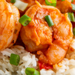 Up close image of plated shrimp on a bed of rice.
