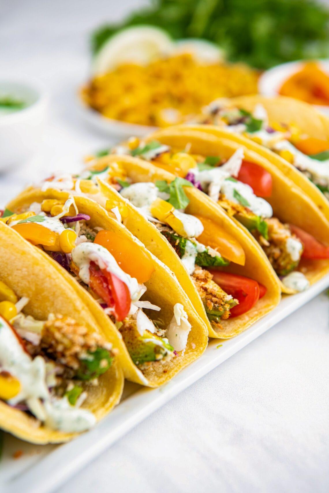 Avocado tacos on a white plate
