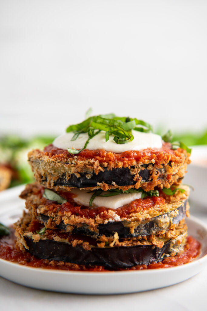 Stacked eggplant parmesan on a plate