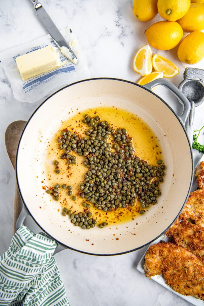 Capers in a pan with oil