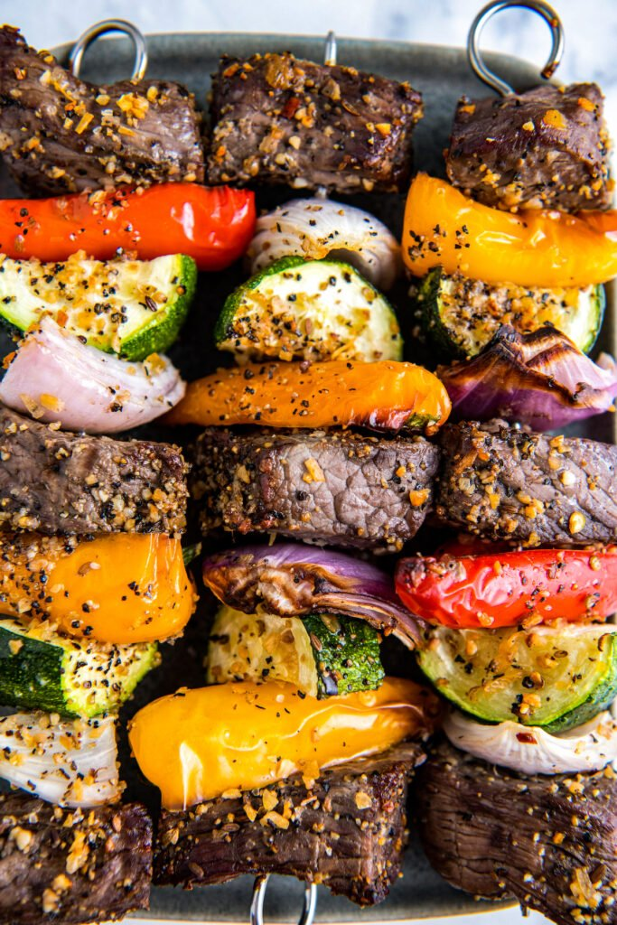 Shish Kabobs with meat, zucchini, onion, peppers and lots of seasoning
