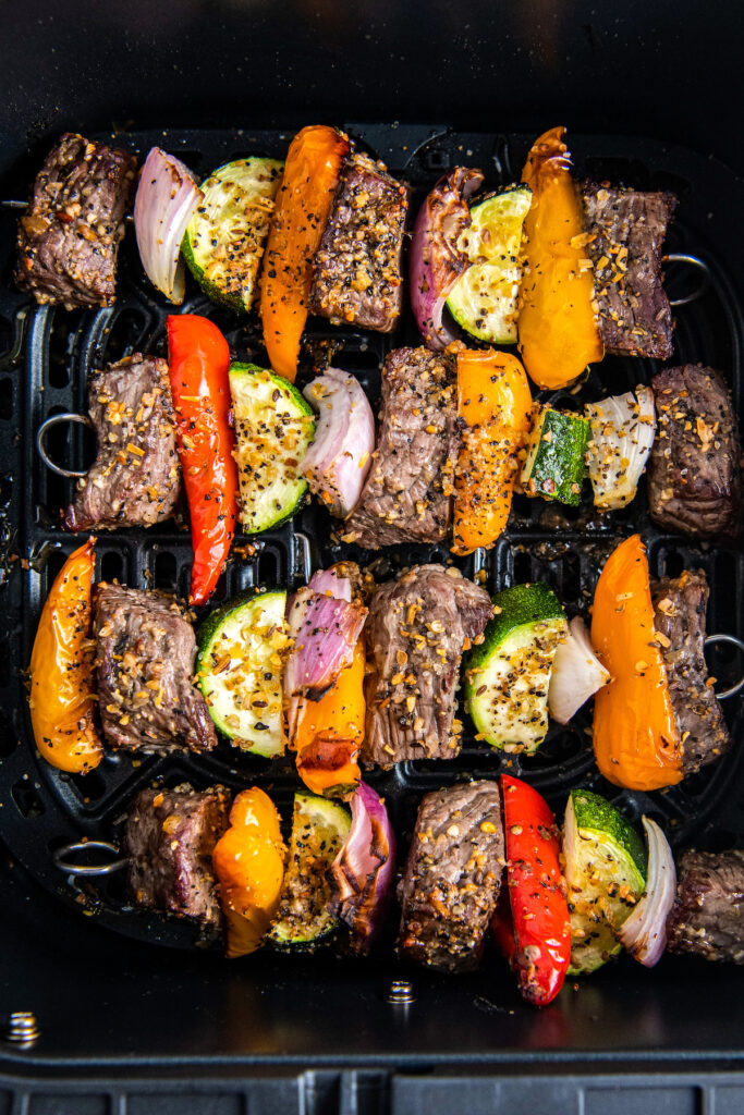 Cooked shish kabobs in air fryer basket