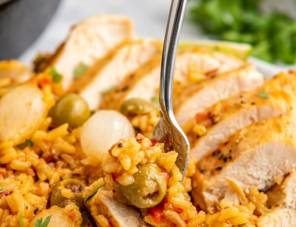 A plate filled with Spanish rice and chicken