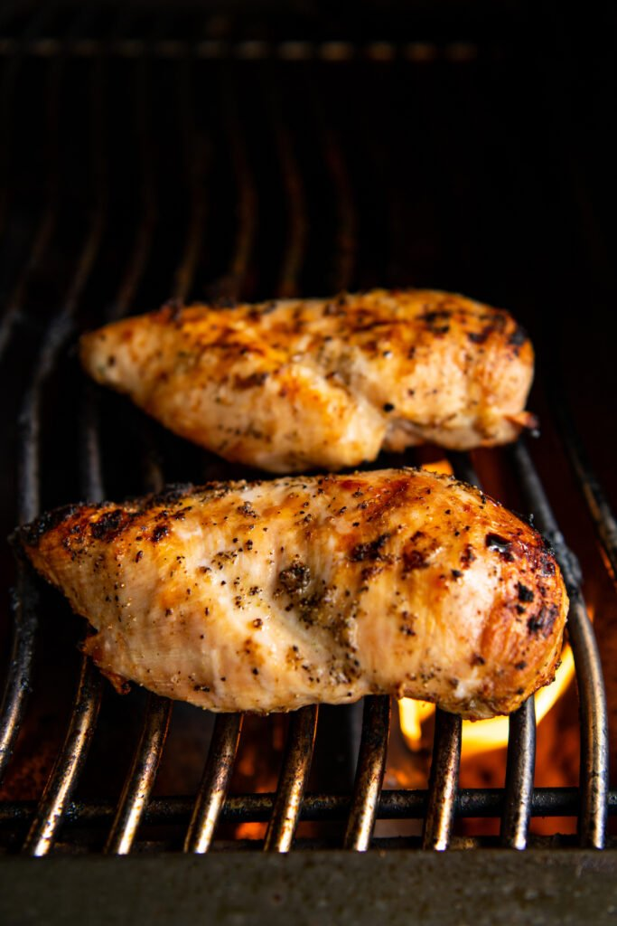 Grilled chicken breast on a gas grill