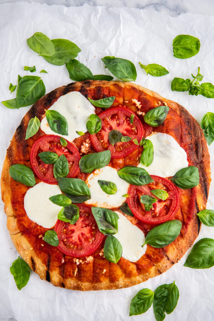 Margherita pizza with fresh tomatoes, basil and mozzarella cheese