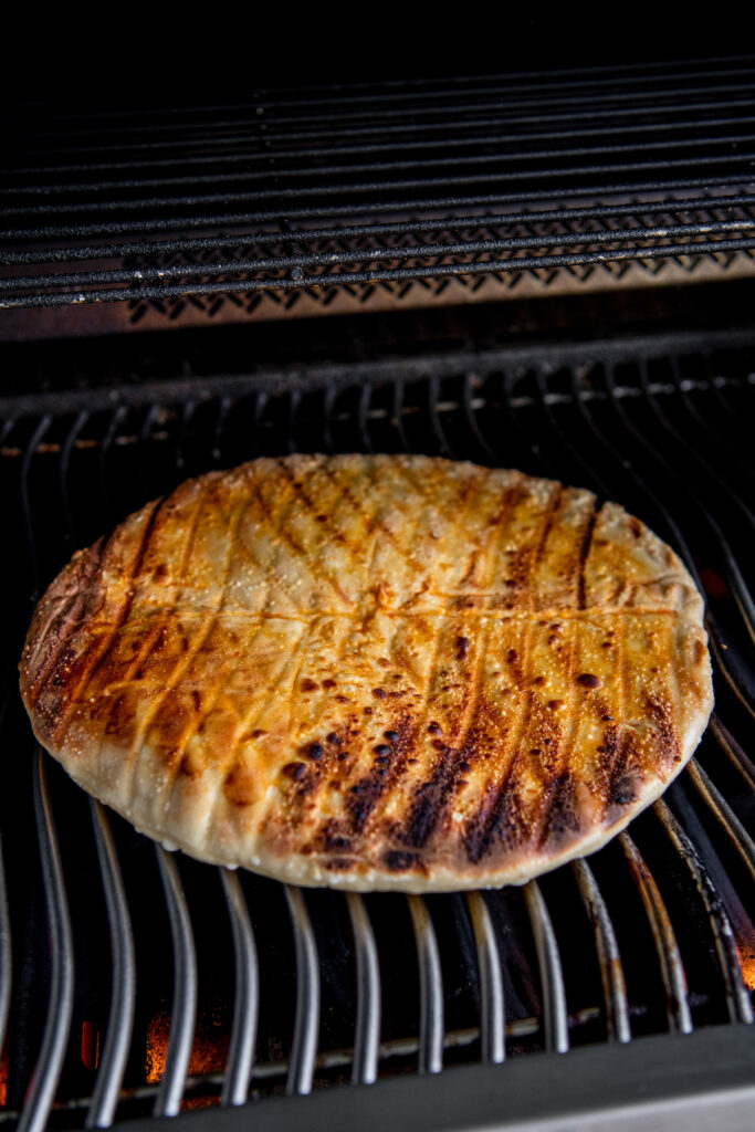 Pizza crust on a gas grill