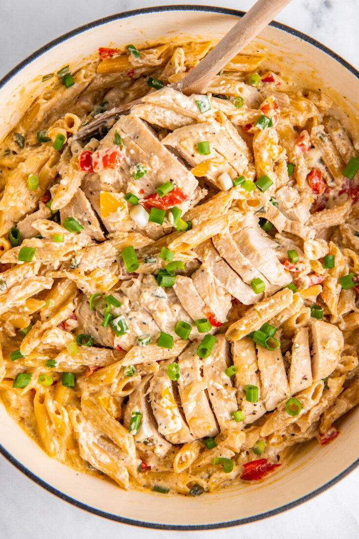 Chicken and pasta are in a pot, fully cooked and ready to eat.