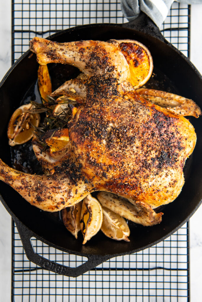 The chicken is fully cooked and the skin is browned.
