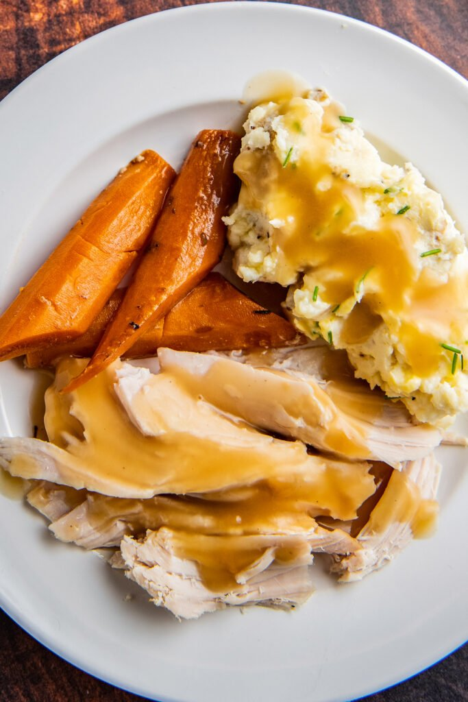 turkey, carrots, and mashed potatoes on a plate