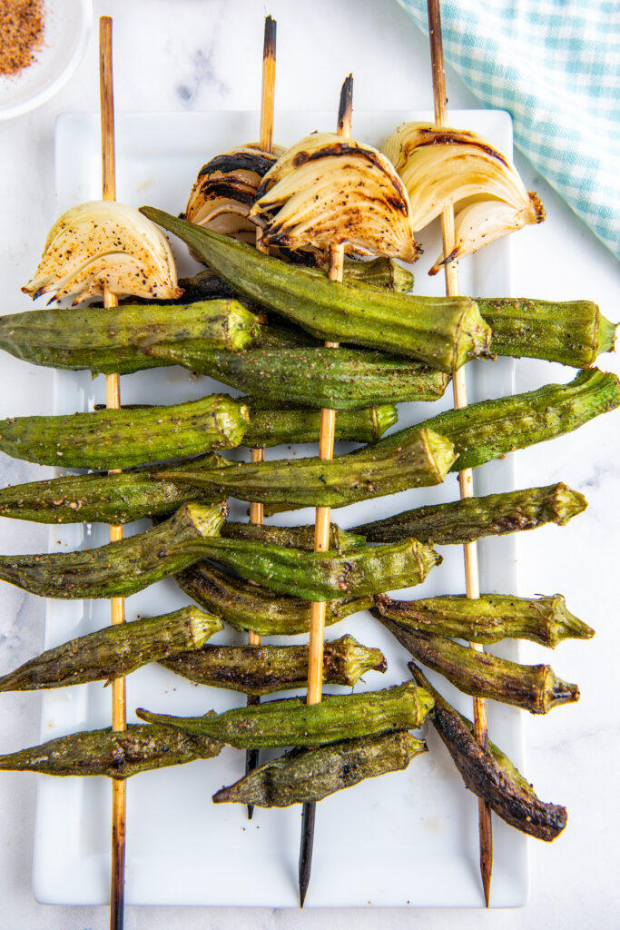 grilled okra on skewers with onions and other seasonings