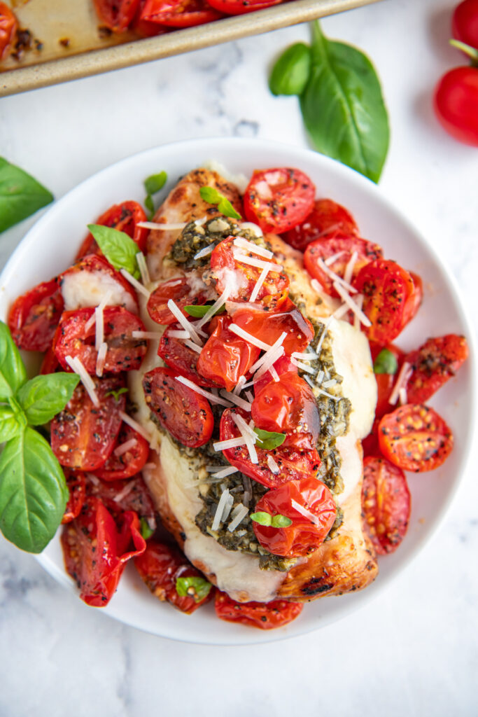 Tomatoes and grilled chicken are topped with shredded cheese for this chicken caprese.