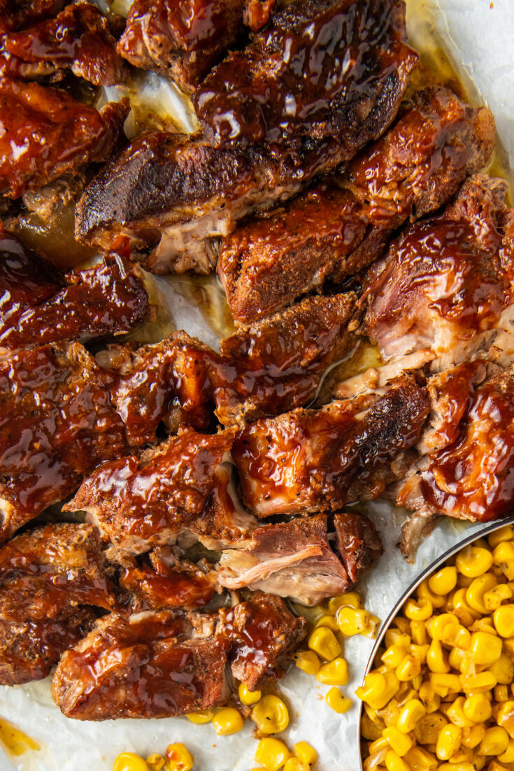 country style ribs with corn on parchment paper