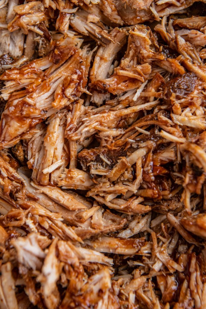 Overhead image of dr. pepper pulled pork with bbq sauce.