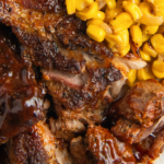Overhead image of country style ribs cooked in a crockpot.