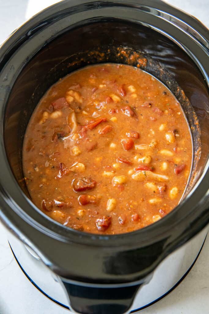 Overhead image of white chicken chili in a bowl of the crockpot.