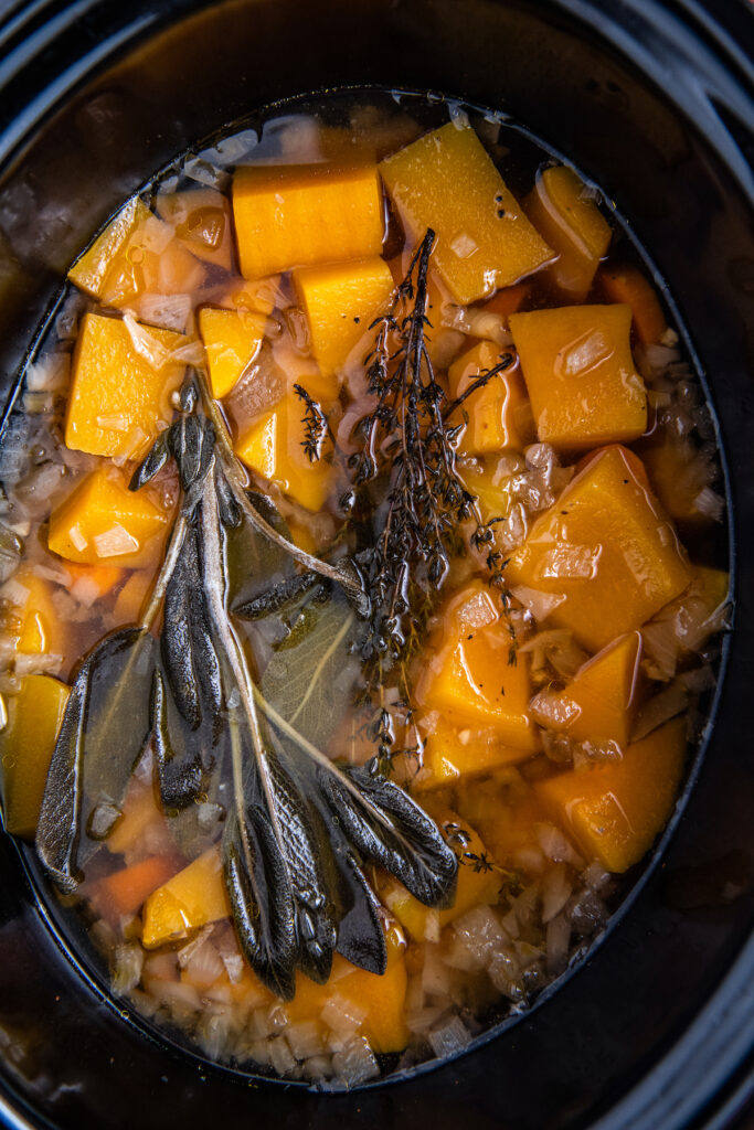 Butternut squash after cooking with browned herbs on top.